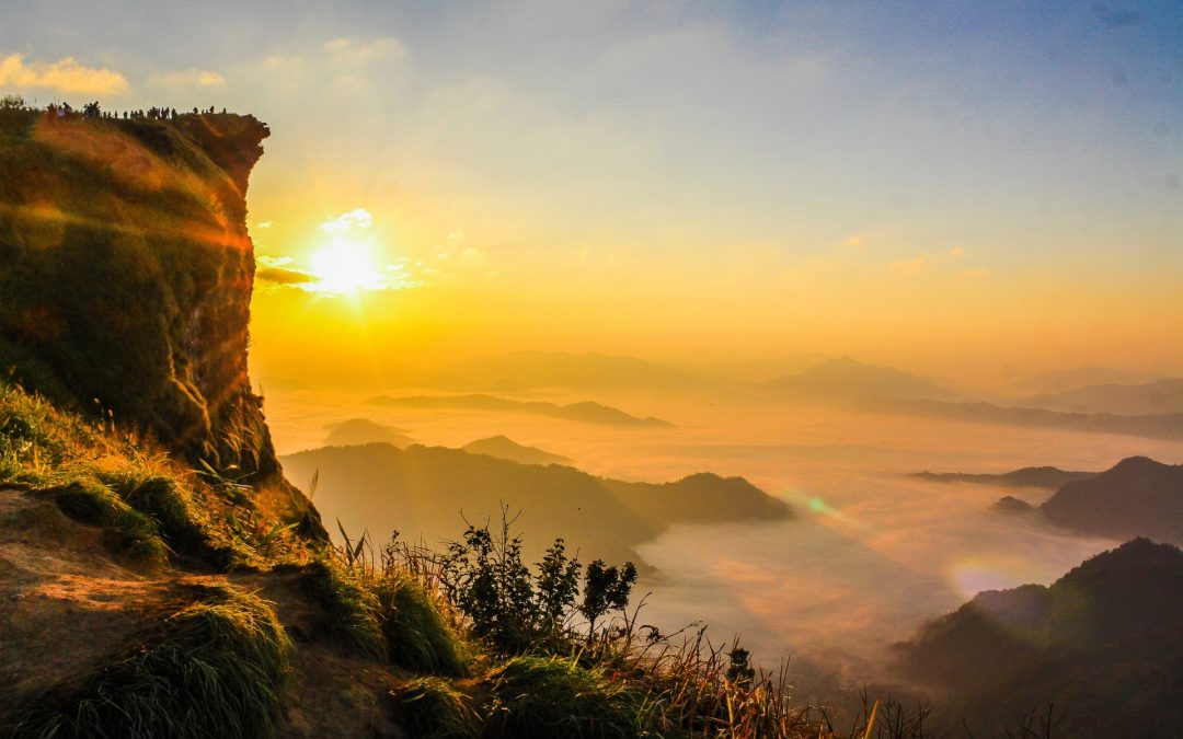 "header picture of the ""Starting every day with the right foot forward"" article, beautiful picture of a sunrise landscape taken from the top of a mountain"